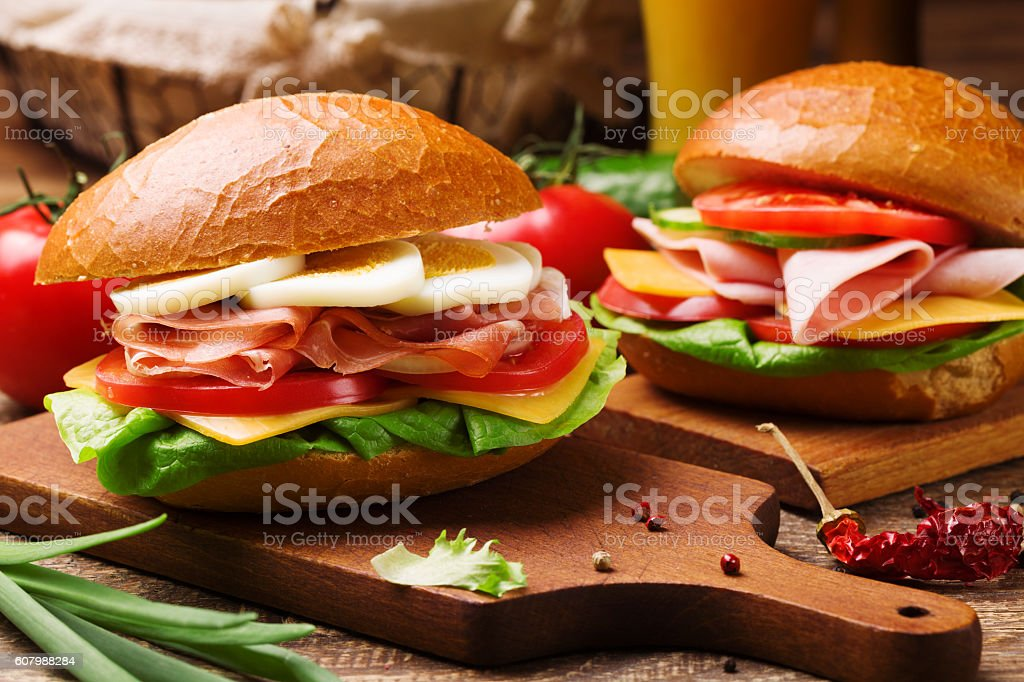 Prosciutto ham sandwich with egg and vegetables. stock photo