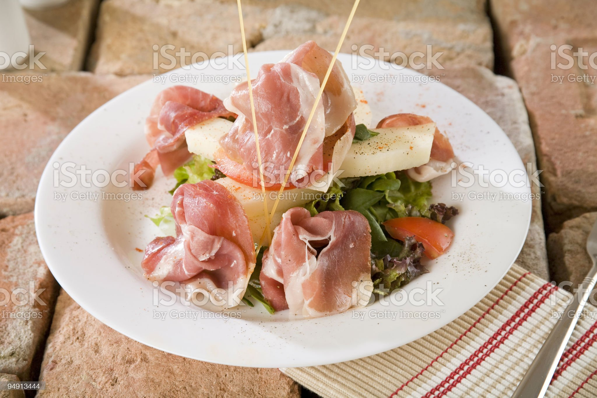Prosciutto ham with salad royalty-free stock photo