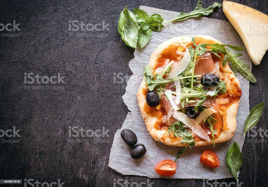 Prosciutto mini pizza stock photo
