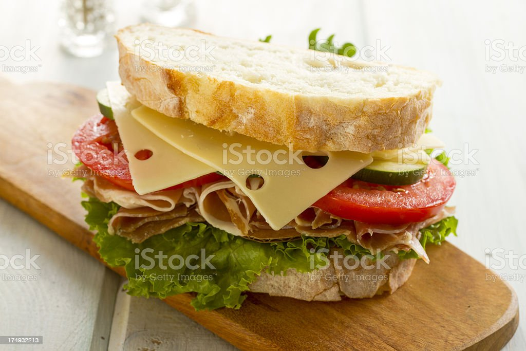 Prosciutto Sandwich With Chips On Waxed Paper stock photo