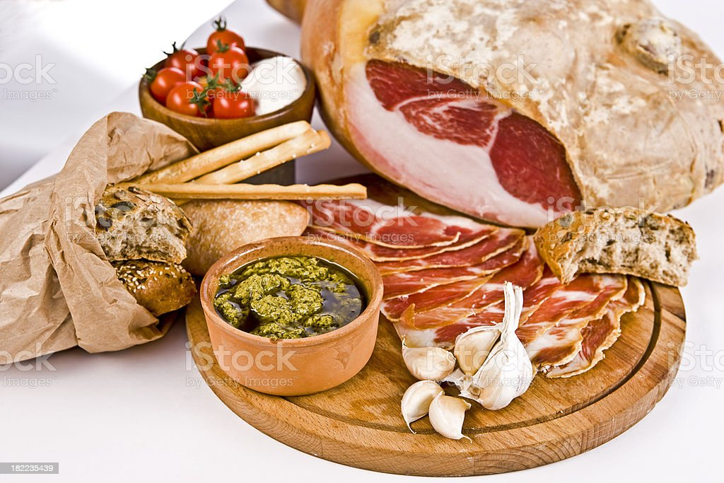 Prosciutto (Italian Ham) with Bread , Garlic and Red Tomatos royalty-free stock photo