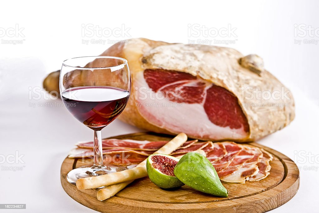 Prosciutto (Italian Ham)  with Fig and Red  Wine, Front View royalty-free stock photo