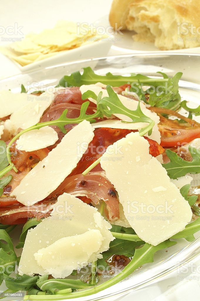 proscuito tomato and rocket salad with shaved parmesan stock photo