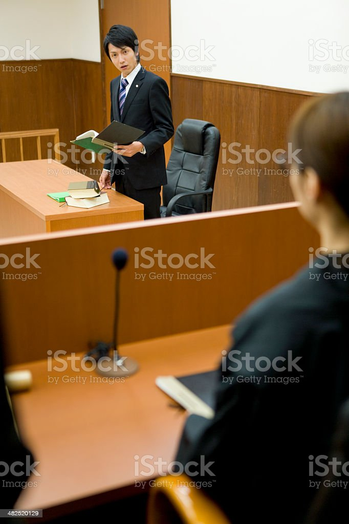 Prosecutor expressing his opinion to judge stock photo