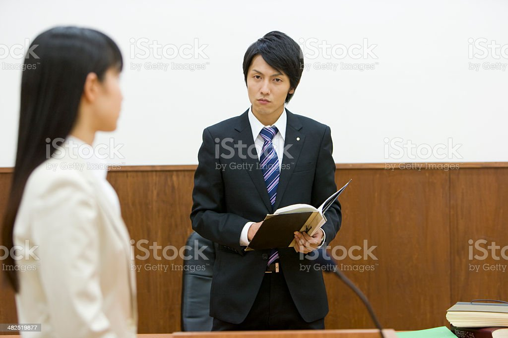Prosecutor talking to person who takes the witness stand stock photo