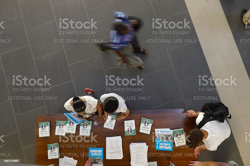 Prospective students collecting course material at university open day stock photo