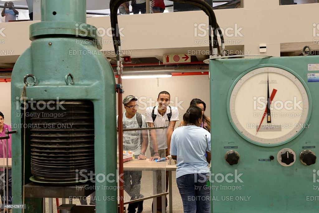 Prospective students listening to engineer postgraduates stock photo