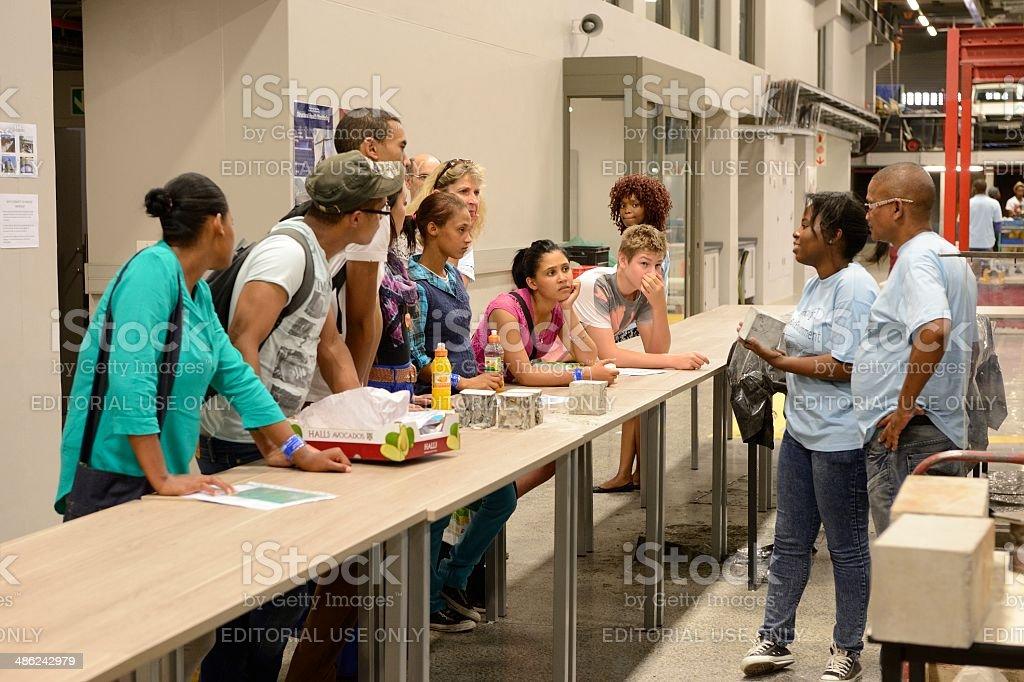 Prospective students listening to postgraduates at university open day stock photo