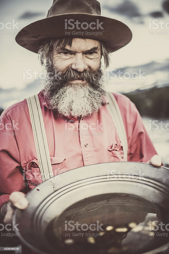 Prospector with Gold Nuggets stock photo