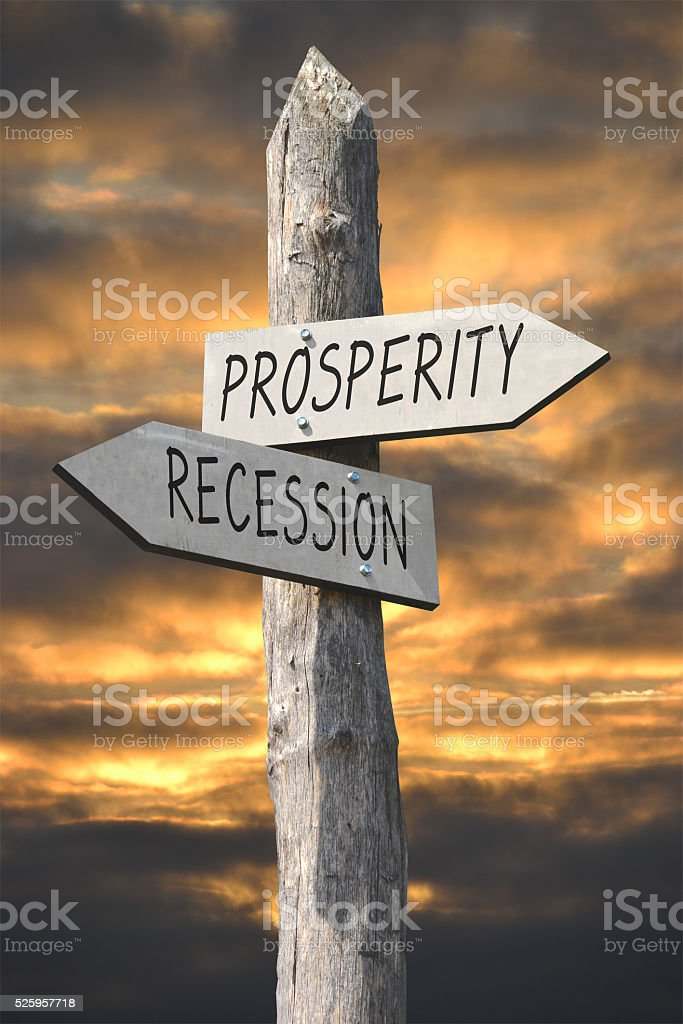 Prosperity and recession signpost stock photo