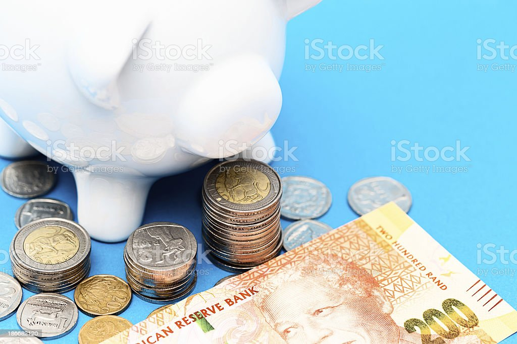 Prosperous piggybank guards Two Hundred Rand banknote and silver stock photo