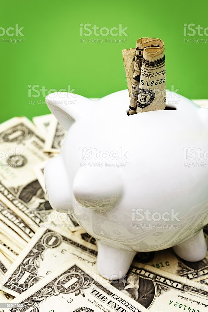 Prosperous piggybank overflowing with dollars royalty-free stock photo