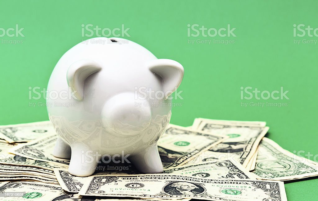 Prosperous piggybank with lots of pocket money dollars royalty-free stock photo
