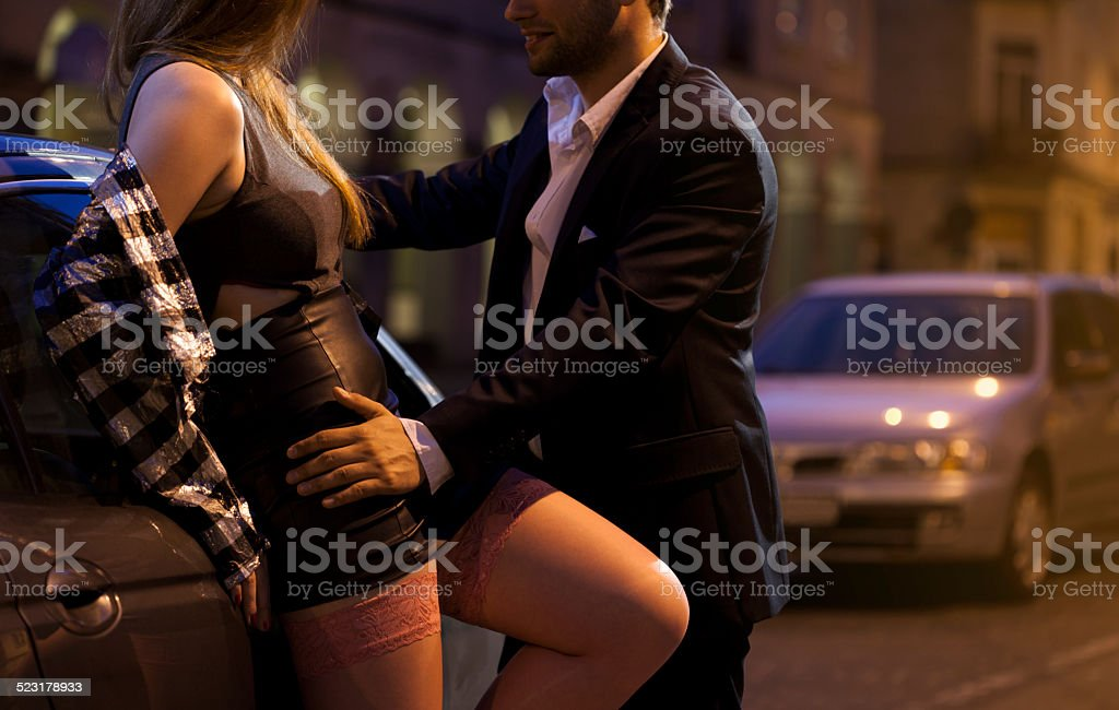 Prostitute flirting with businessman stock photo