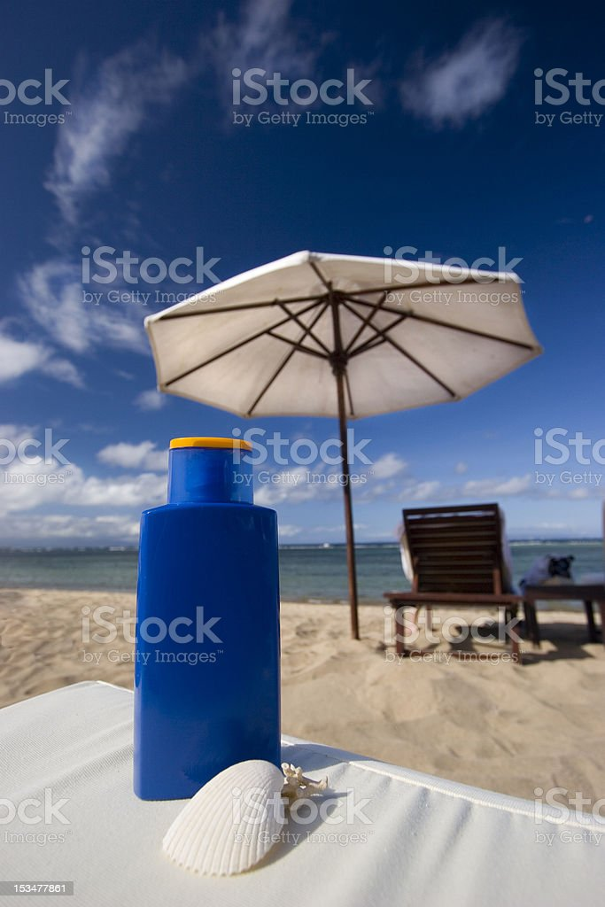 Protect from sun on the beach with tanning oil stock photo