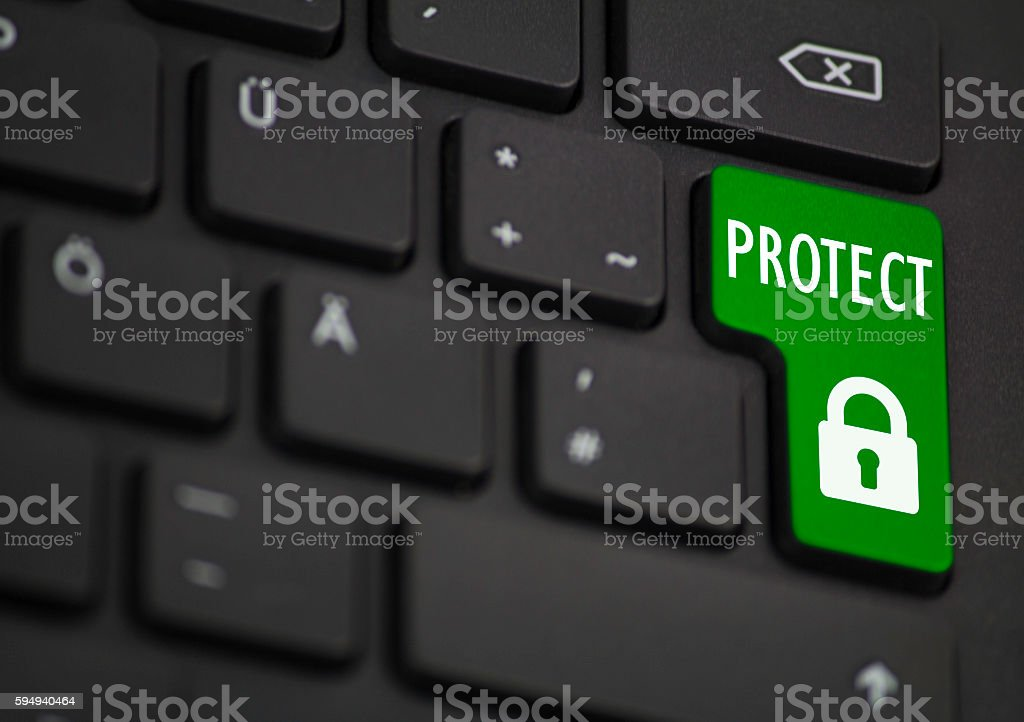 Protect Symbol on the return key, colored in Green stock photo