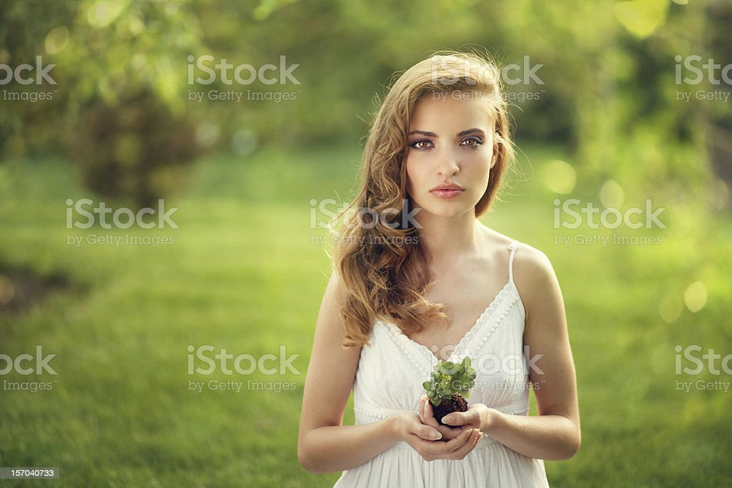 protect the nature - girl holding small plant royalty-free stock photo