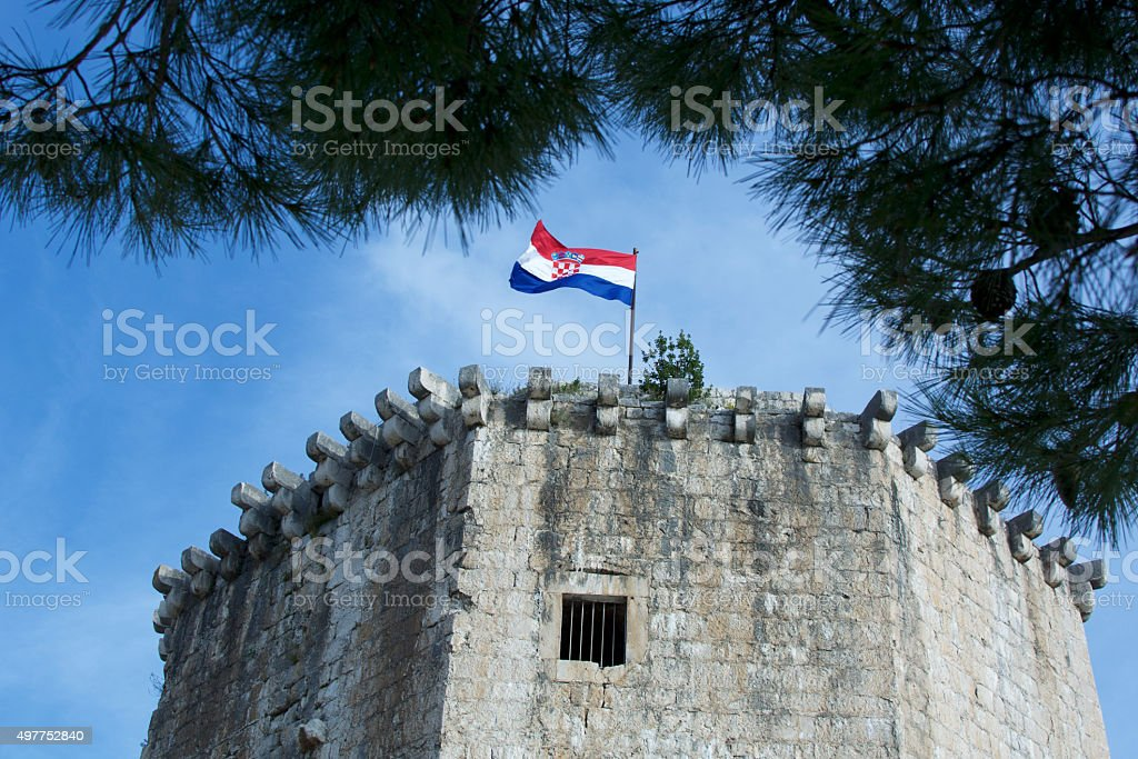 UNESCO protected tower with Croatian flag on top. stock photo