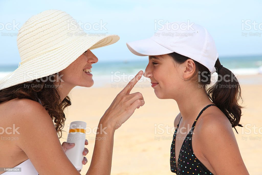 Protecting children's skin from the sun stock photo