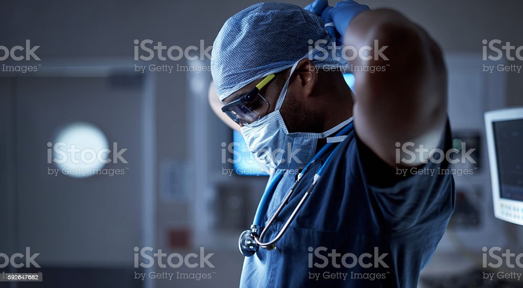 Protecting his patient and himself from germs stock photo