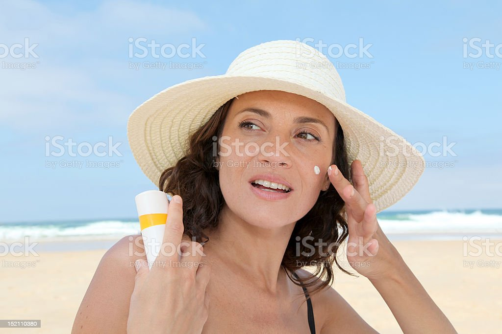 Protecting skin from the sun stock photo