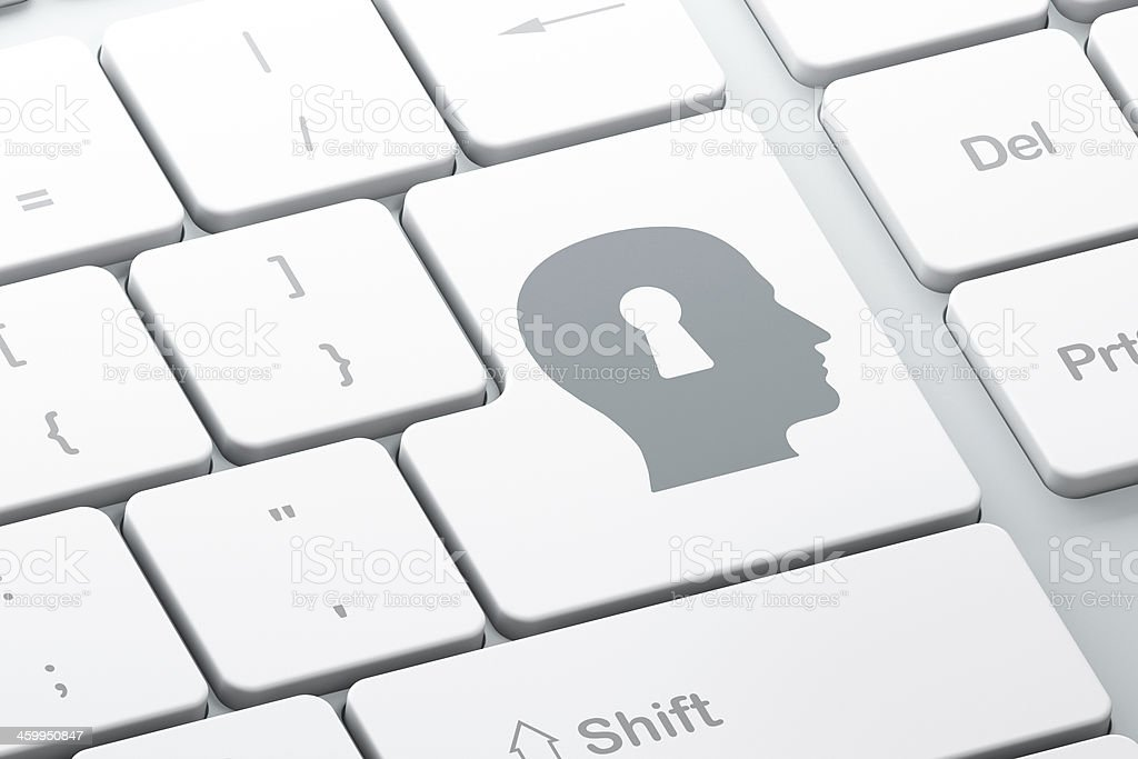 Protection concept: Head With Keyhole on computer keyboard backg stock photo