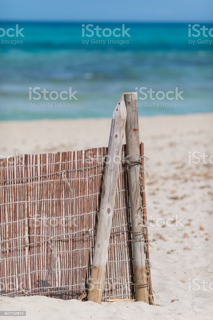 protection fence at ocean beach - for sanddunes and plants stock photo