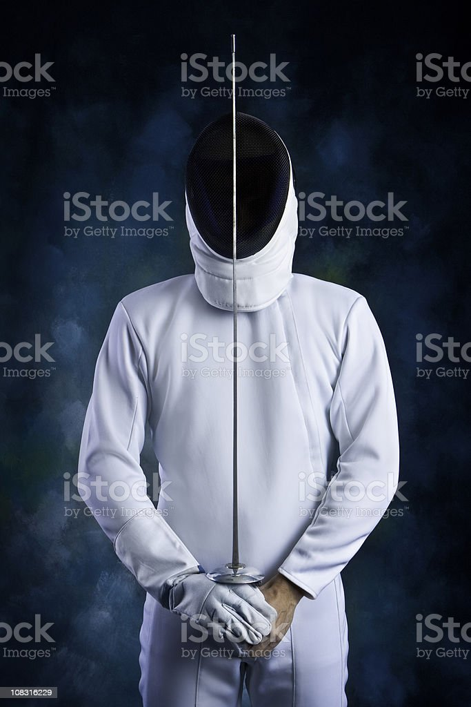 Protection: fencer ready to fight. stock photo