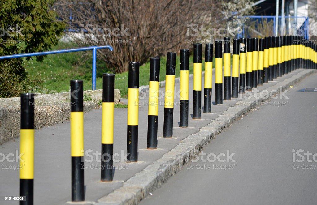 Protective bollards along the sidewalk stock photo
