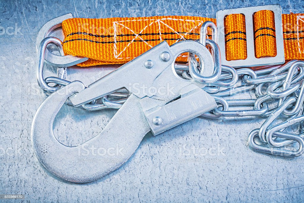 Protective construction strap on scratched metallic background stock photo