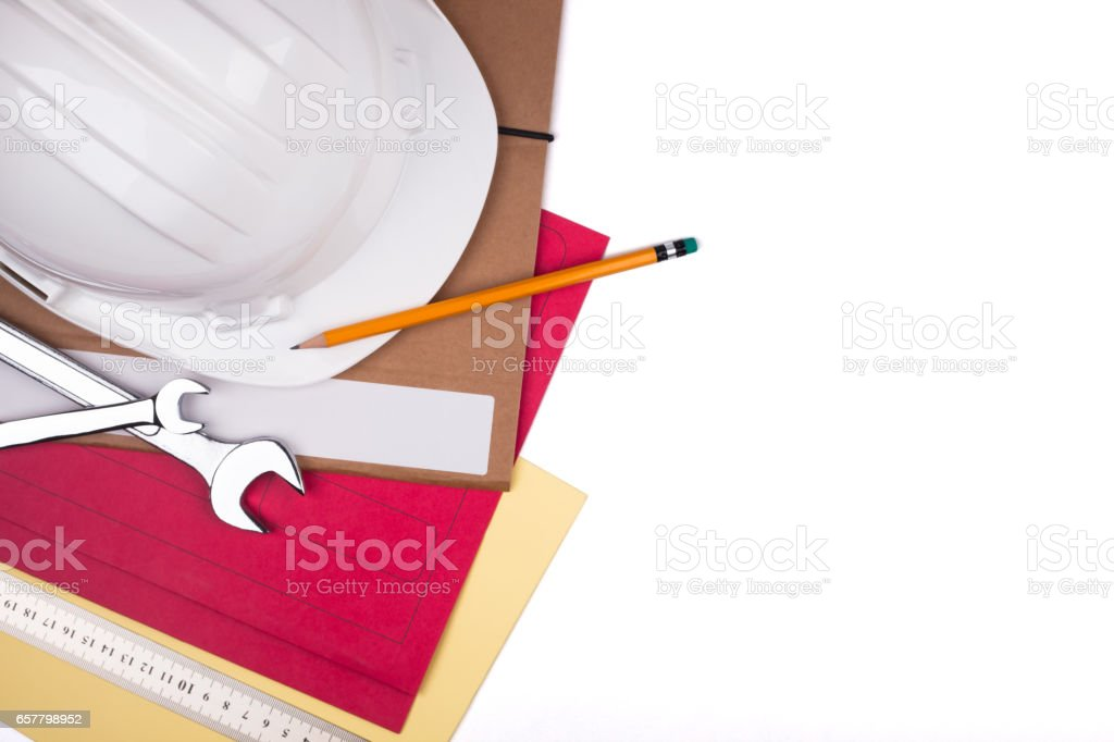Protective helmet and wrenches. stock photo