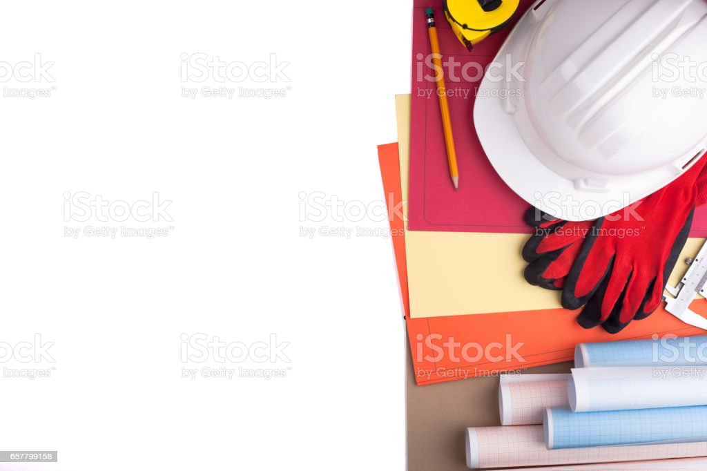 Protective helmet, gloves and rolls of graph paper. stock photo