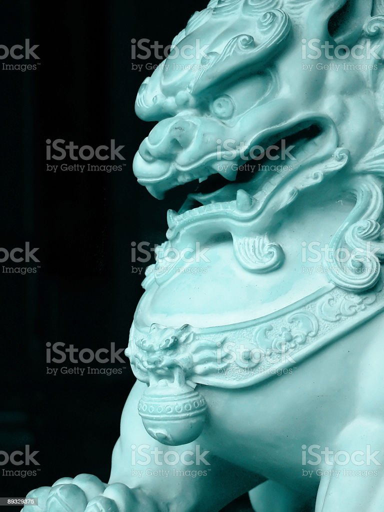 Protective Jade Chinese lion at front door of buddhist temple stock photo