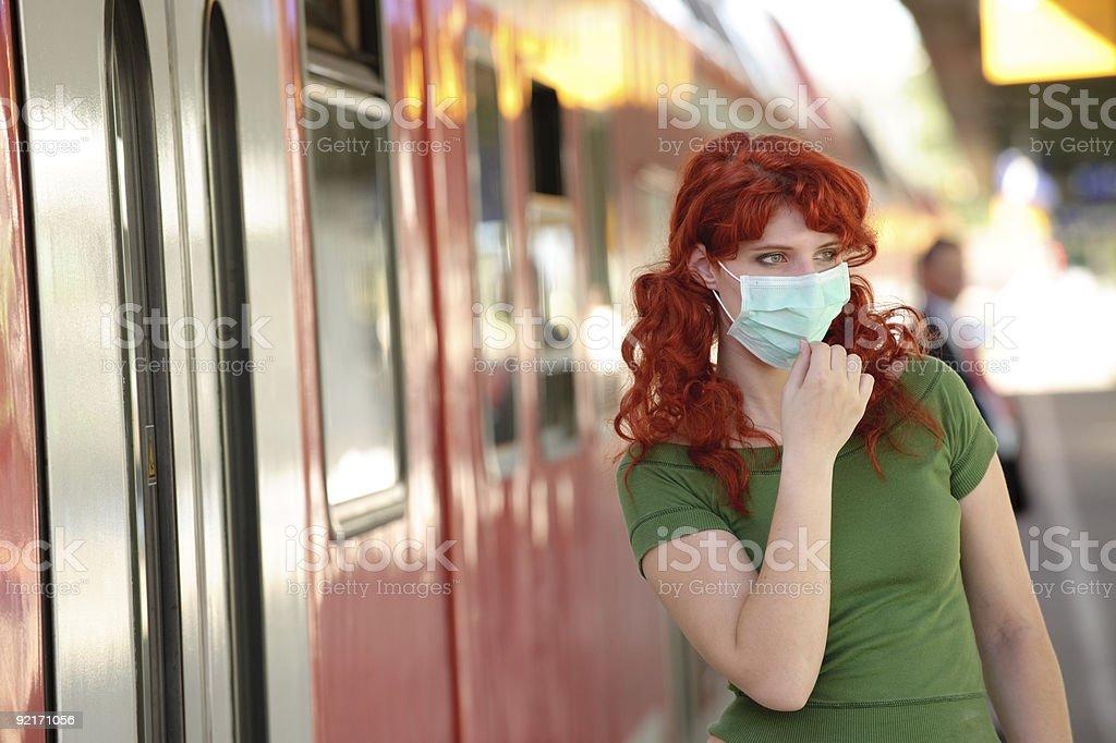 Protective mask at railway station royalty-free stock photo