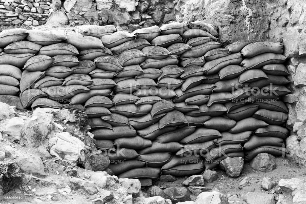 Protective wall of sandbags stock photo