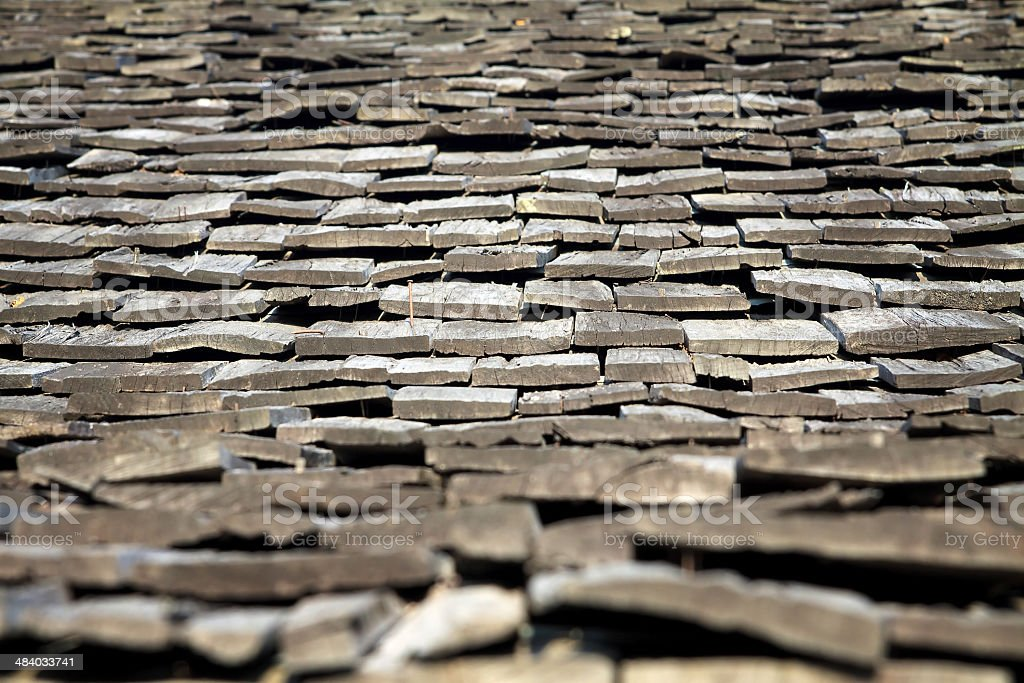 Protective wooden shingle on the roof. stock photo