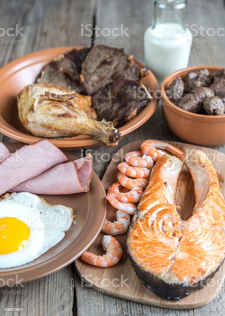 Protein diet:cooked products on the wooden background stock photo