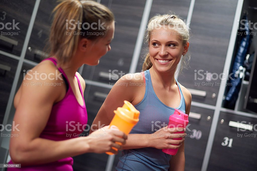 Protein drink after very tiring training stock photo