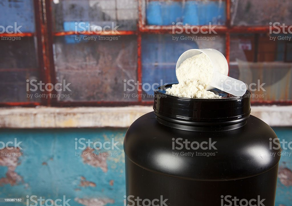 Protein powder and black plastic container stock photo