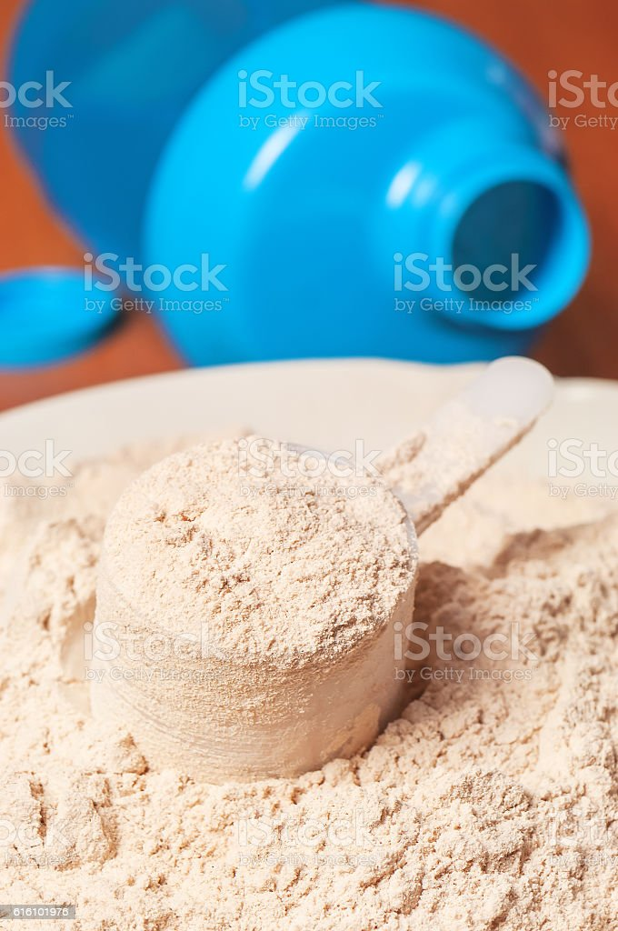 protein powder and blue shaker stock photo