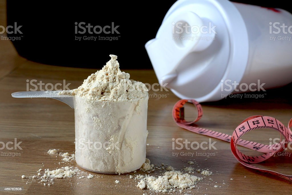 Protein Shake and measuring tape stock photo