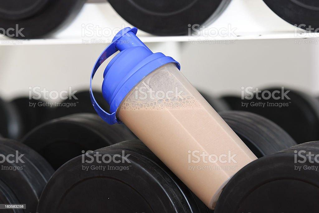 protein shake on dunbbells stock photo