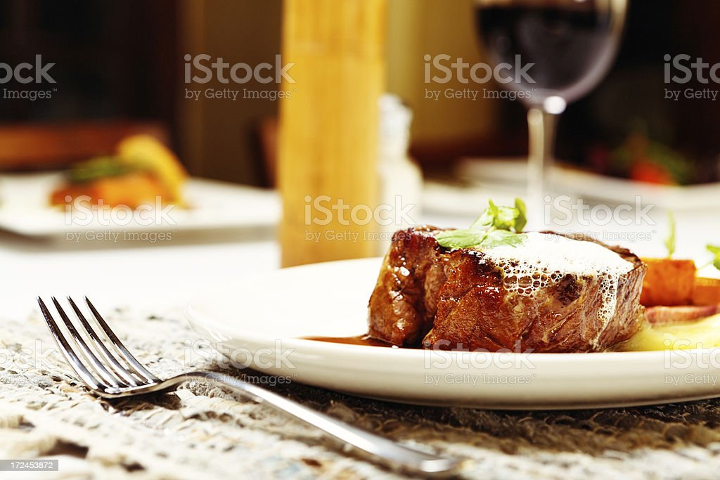 Protein-rich restaurant meal of grilled steak with red wine stock photo