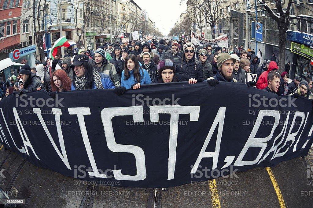Protestant wearing a big poster 'Acta la Vista' royalty-free stock photo