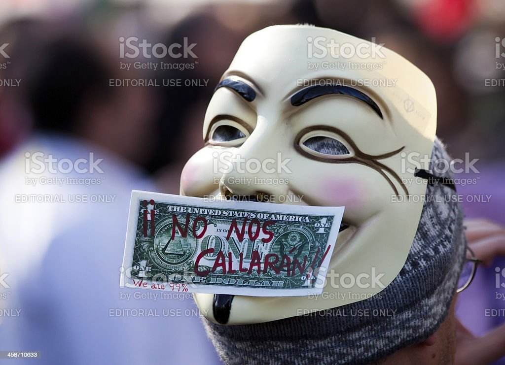 Protester wearing a Guy Fawkes mask, Anonymous royalty-free stock photo