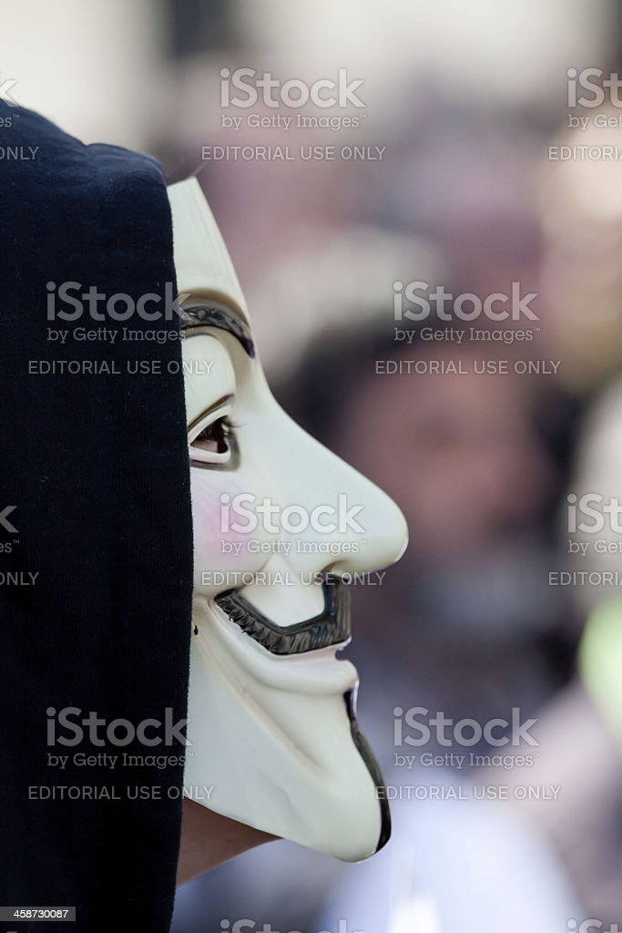 Protester wearing a Guy Fawkes mask, Anonymous stock photo