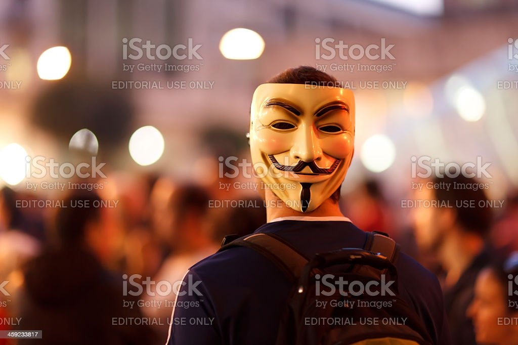 Protester wearing a Guy Fawkes mask. stock photo