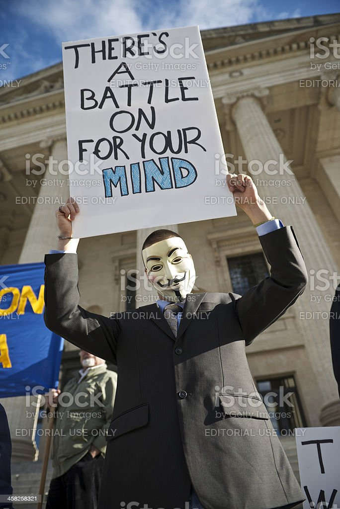 Protester Wearing Guy Fawkes Mask royalty-free stock photo
