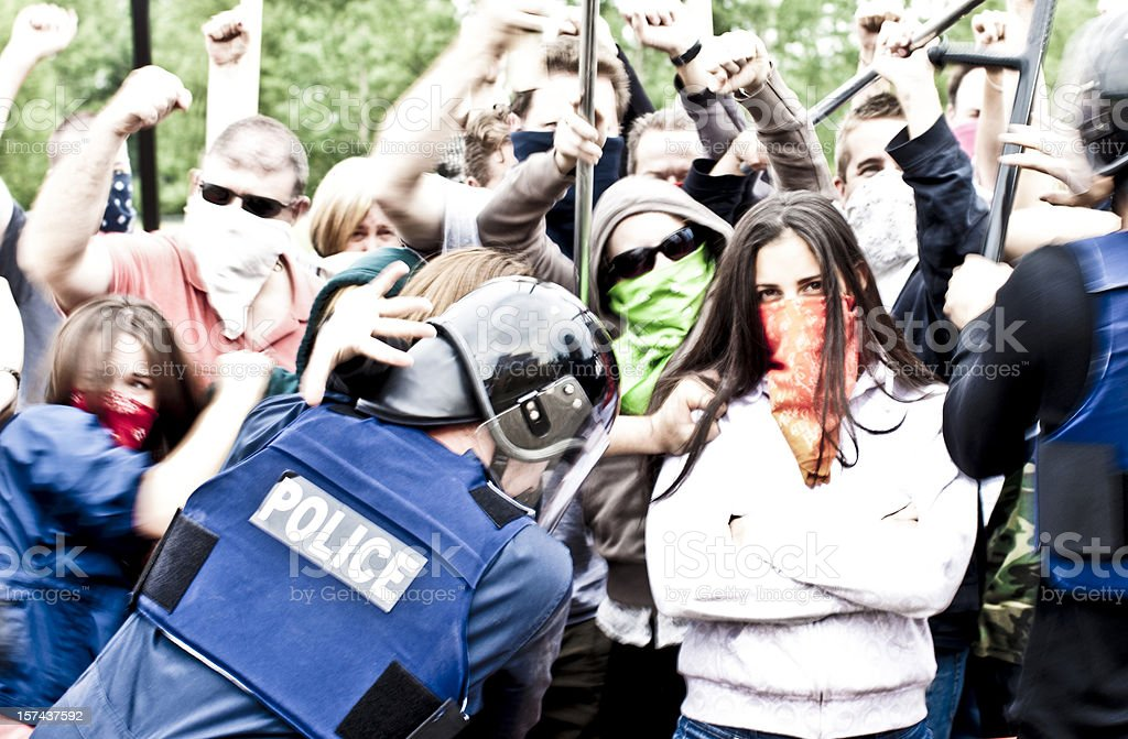 Protesters at a police line stock photo