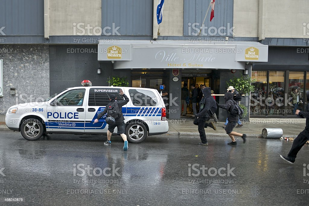 Protesters Chase Police Vehicle royalty-free stock photo